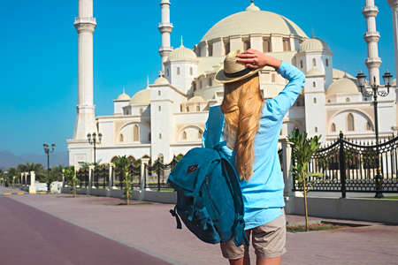Young traveler woman by the Sheikh Zayed Grand Mosque in Fujairah, United Arab Emirates