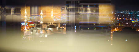 View of Fujairah City in the night. United Arab Emirates, Middle East. Double exposure Stock Photo