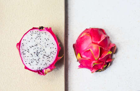 Sliced dragon fruit on the light background. Close up. Top view Imagens
