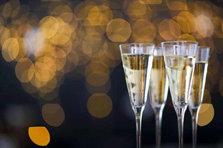 Champagne glasses on lights background. Celebration background Banco de Imagens