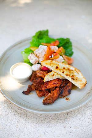 Salad with roastbeef, tofu, tomatoes, salad and vegetables