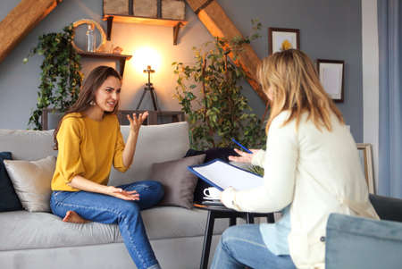 Psychologist having session with her female patient in her private consulting room