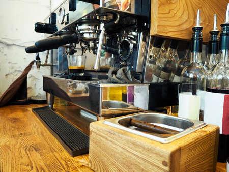 Espresso machine making coffee in pub, bar, restaurant. Toned photo. Close up Фото со стока
