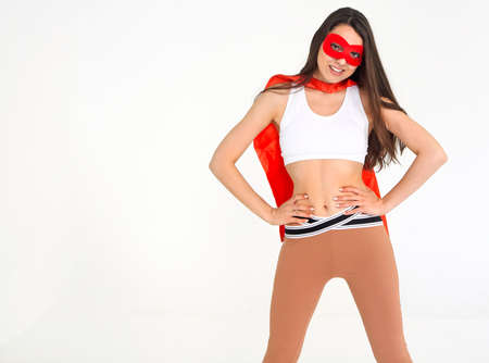 Young superwoman wearing sport clothes and looking fun