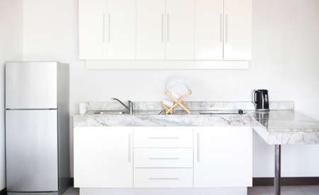 Part of the white kitchen interior in a new modern apartment in scandinavian style 版權商用圖片