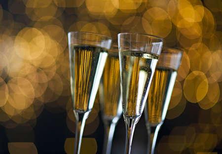 Champagne glasses on lights background. Christmas celebration background