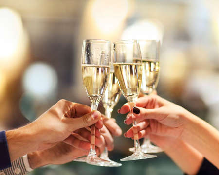 Celebration. People holding glasses of champagne making a toast. Champage with blurred background Stock fotó