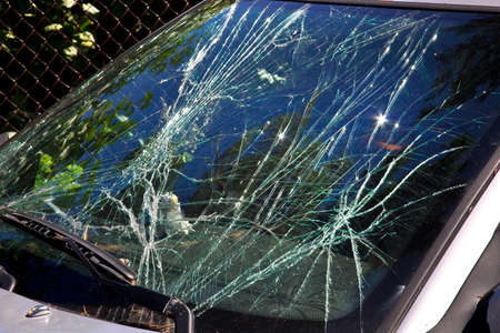 Smashed the windscreen of the car in summer day
