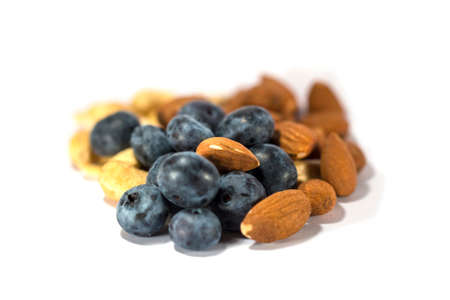 Fresh big blueberry and brown almonds isolated Stock Photo