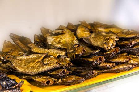 Tasty nice gold smoked fish in street market photo