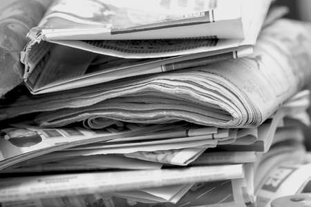 Big mess of newspapers and magazines in black and white photo