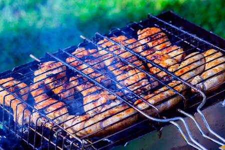 Chicken aromatic skewers on grill at summer garden photo