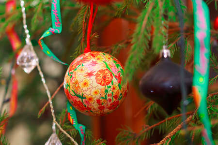 Nice multicolored bead with floral ornament on Christmas tree photo