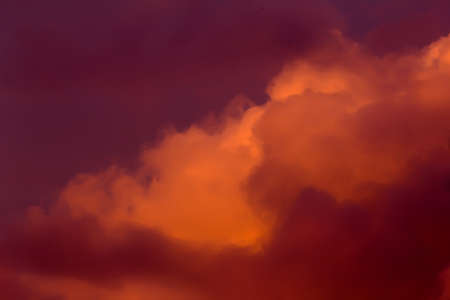 Nice lush clouds in fiery red tones Stock Photo