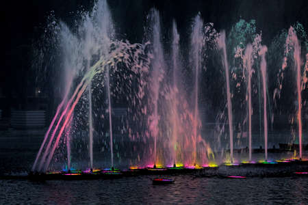 beauty fountain: Beauty illuminated musical fountain on summer evening Stock Photo