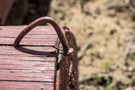 driven: Bent nail driven into block of wood on sunny day Stock Photo