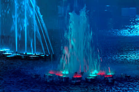 beauty fountain: Beauty illuminated musical fountain on summer evening with color center