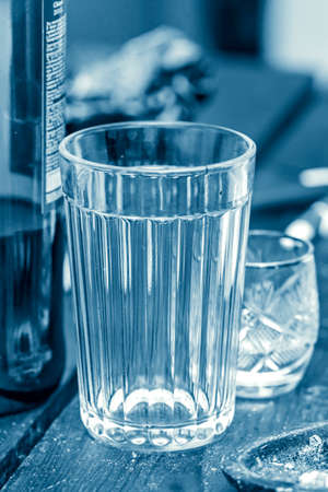 medicate: Empty faceted glass closeup in blue tones Stock Photo