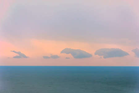 dawn sky: Number of clouds against pink dawn sky over sea