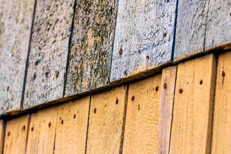 nailed: Blue and yellow old wooden boards nailed Stock Photo