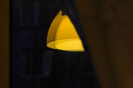 keystone light: Nice yellow shade lampshade reflection in dark window Stock Photo