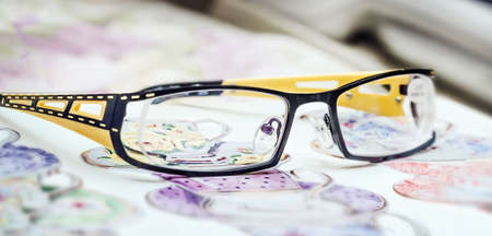 refractive: Nice glasses black and yellow frame for person Stock Photo