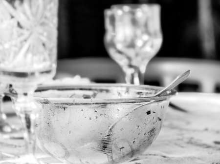leavings: Really mess on morning table after big party, in black and white