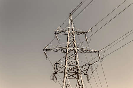 voltage gray: High tower power line in abstract gray sky background Stock Photo