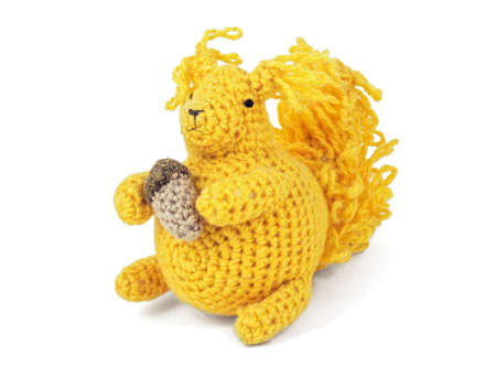squirrel isolated: Nice yellow crochet toy squirrel isolated on white