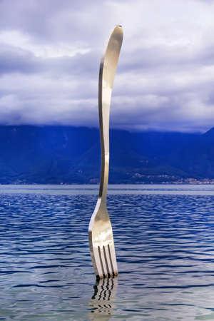 vevey: Vevey, Switzerland - October 6, 2013: fork in Geneve lake, symbol of modern art in water