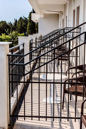 Balconies with tables and chairs at best sunny weather Stock Photo