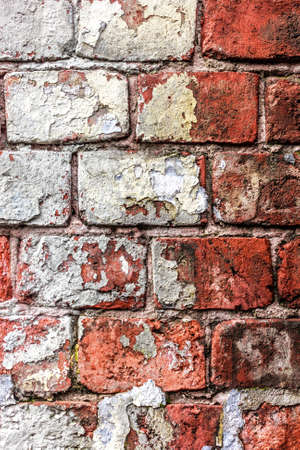 Old brick wall with white fragments like symbol of past