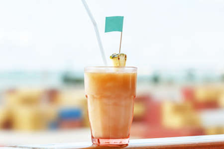 Coctail pina colada on ocean happy day background