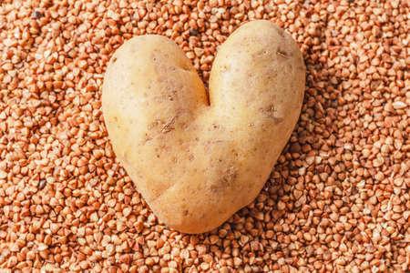 Heart-shaped potatoes on buckwheat like original model Stock Photo