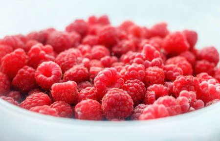 Fresh red ripe raspberies in light plate for pleasure Stock Photo