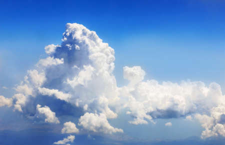 Great snow white clouds in blue sunny sky