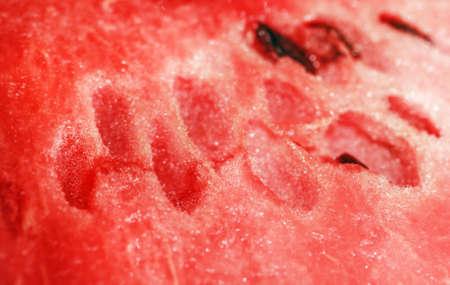 Red tasty ripe flesh of pretty watermelon