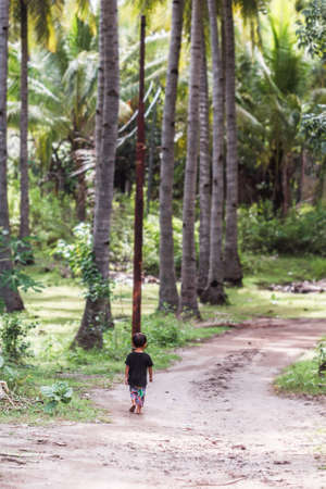 January, 5. 2017, Gili air, Indonesia - little boy in palm grove