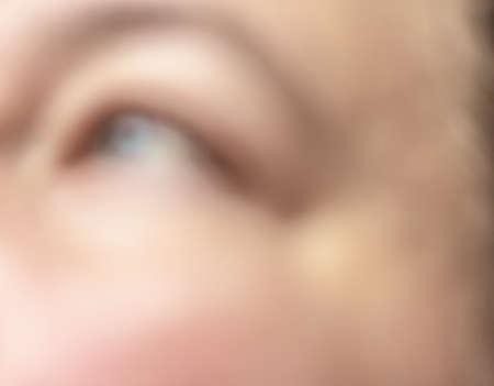 Blurred blue eye for use like symbol of interesting sign