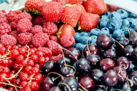 Pretty fresh ripe berry platter for good mood