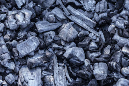 Black extinct embers of fire after holiday