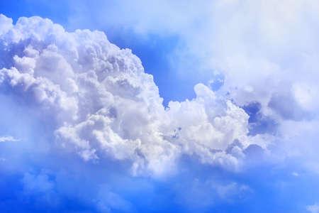 Pretty white  clouds in sunny blue sky Stock Photo