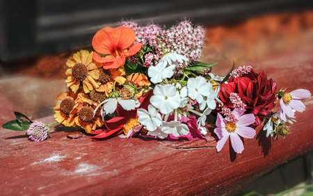 Pretty summer bouquet on wooden step at summer day Stock Photo - 115113241