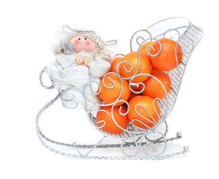 Toy Christmas New Year angel with tangerines on white background Stock Photo