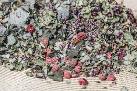 Dry herbal tea with raspberry berries for tasty party and health Stock Photo