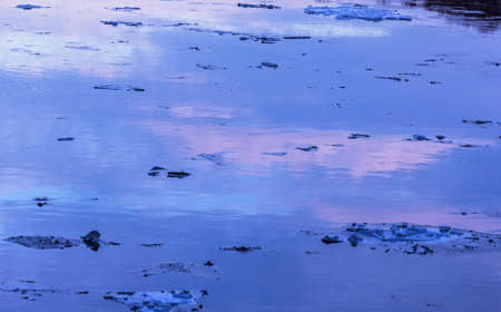 Twilight in winter water with ices in blue and pink pastel colors Stock Photo - 114742009