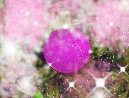 Pink lilla glowing ball of threads on Christmas tree in bright stars