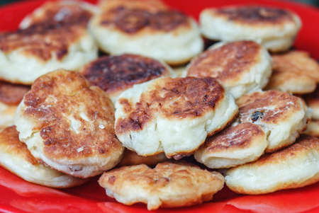 Beauyt fresh home cheese pancakes hand made on red plate Stock Photo - 114742025