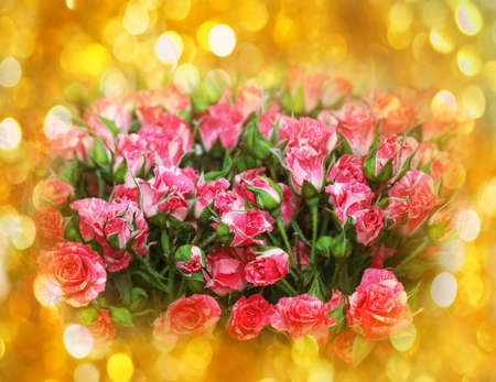 Pretty pink roses in gold sequins for holiday mood Stock Photo - 114742052