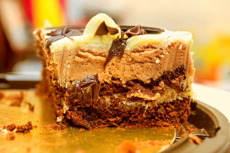 Fresh tasty chocolate cake with dark and light layers for tasty mood Stock Photo - 114742062